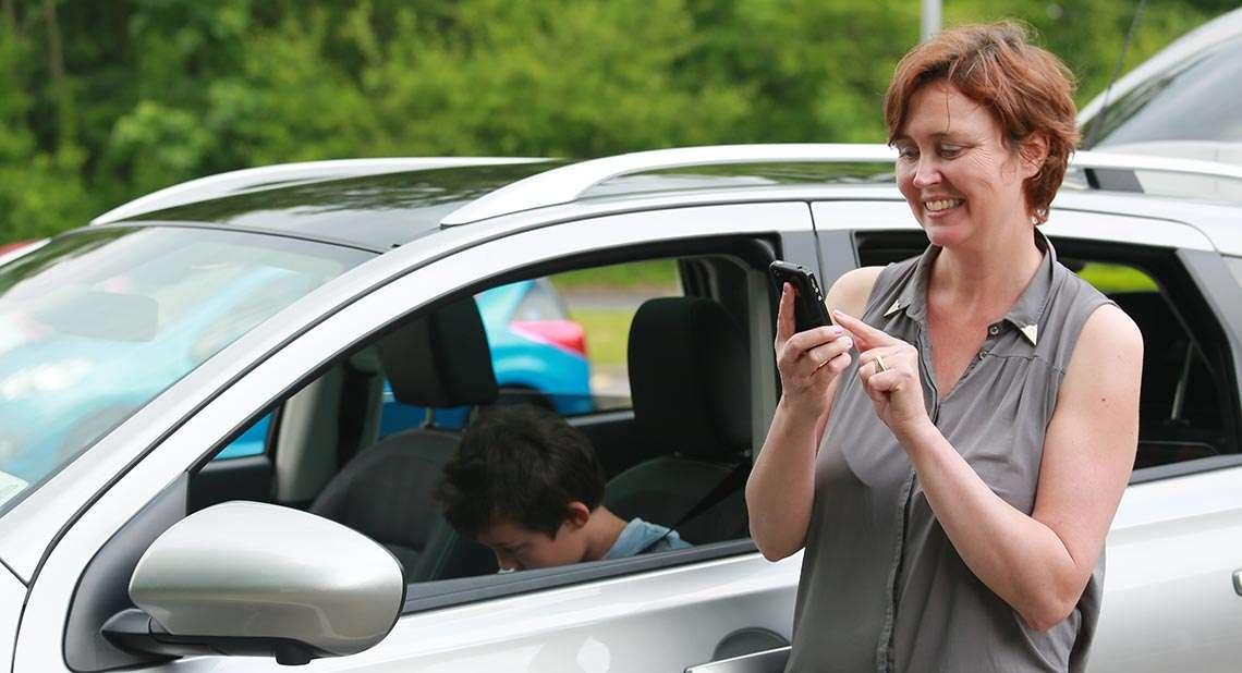 Motability Scheme customer using mobile phone